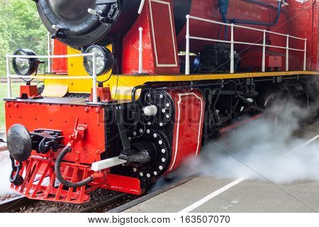 Steam locomotive blowing off the steam before moving