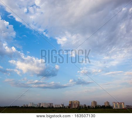 Urban landscape. Kyiv (Ukraine) high-rise buildings and cloudy sky.