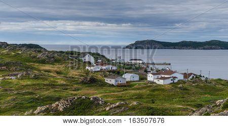 Small village community in Newfoundland.  Houses nestled amongst rocky landscape in Twillingate Newfoundland, Canada.