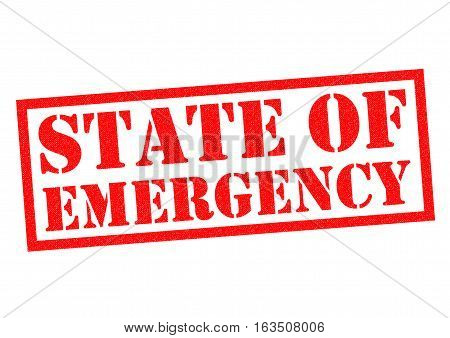 STATE OF EMERGENCY red Rubber Stamp over a white background.