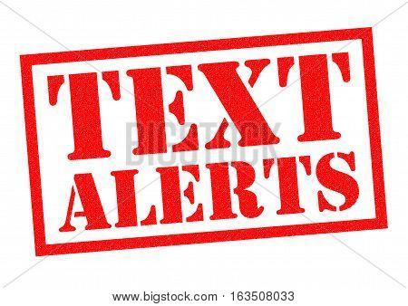 TEXT ALERTS red Rubber Stamp over a white background.