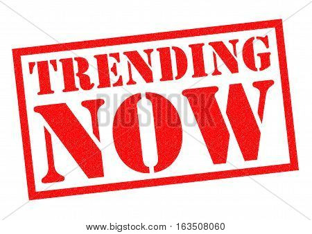TRENDING NOW red Rubber Stamp over a white background.