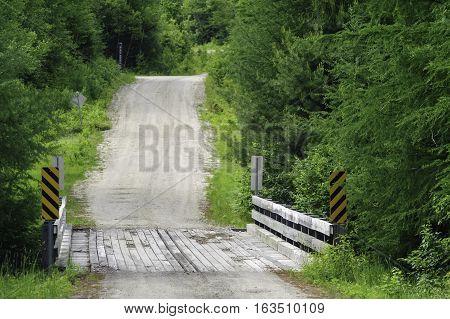 Dirt road short bridge short hill Vermont Northeast Kingdom