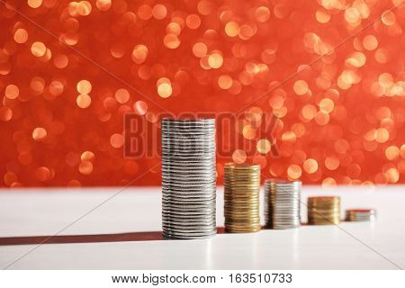 Coins stacks with golden lights sparkling bokeh background. Financial growth concept