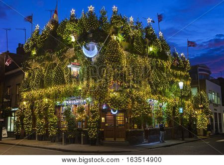 LONDON UK - DECEMBER 9TH 2015: The Churchill Arms Public House decorated within an array of Christmas Trees to celebrate the festive season in Notting Hill London on 9th December 2015.