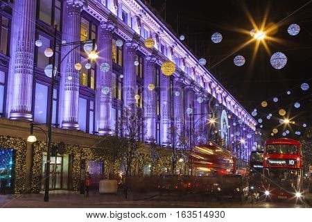 LONDON UK - DECEMBER 9TH 2015: A view of the beautifully illuminated Selfridge department Store during Christmas on Oxford Street in London on 9th December 2015.