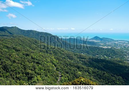 aerial above rainforest canopy in barron gorge national park and coral sea coastline near cairns of queensland australia