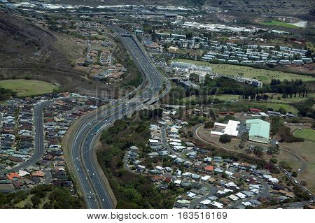 Aerial H-1 Interstate Highway running through Countryside into Honolulu on Oahu Hawaii.