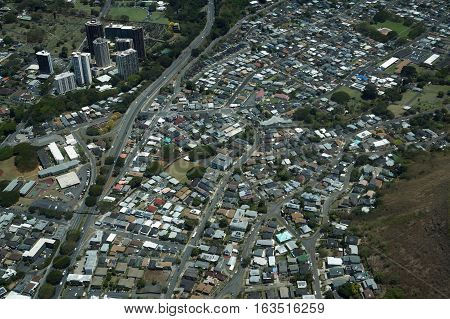 Aerial of Pali Highway Punchbowl and Nuuanu Valley Neighborhood with homes Condos and Graveyards on Oahu Hawaii.