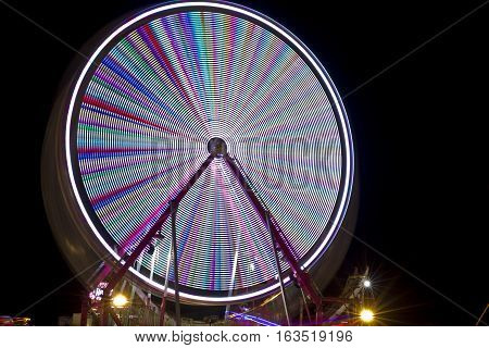 Time exposure of a ferris wheel in an amusement park at night