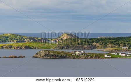 Small village community in Twillingate, Newfoundland.  Homes along shoreline in coastal village, dwarfed by their surroundings along the Island's edges.