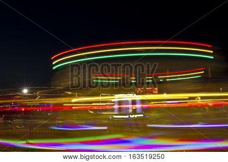 Blurred effect of an amusement park ride taken at night