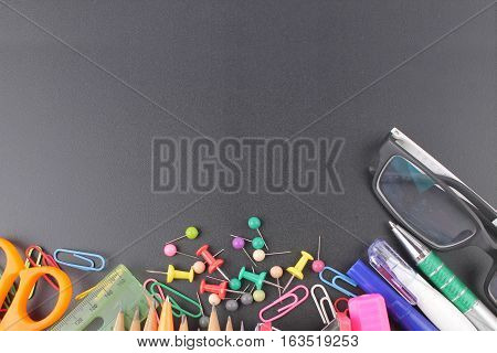 School supplies on chalkboard back to school concept