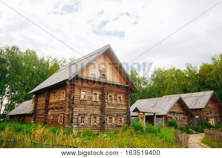 A two-storey wooden house Slavic type and other wooden buildings in rural areas