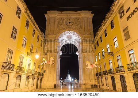 Lisbon, Portugal - November 25, 2016: Augusta Street Triumphal Arch in the Commerce Square Praca do Comercio or Terreiro do Paco at night in Lisbon Portugal.