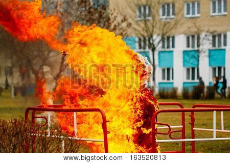 A burning scarecrow depicting a woman the tradition of Slavic holiday Maslenitsa