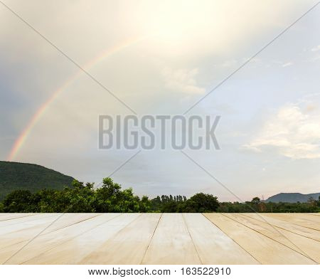 Empty Space Table Top With Mountain Tree And Rainbow On Sky Nature Background