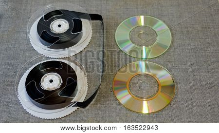 film VHS tapes and CDR discs on a gray background