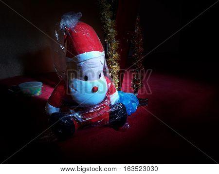 Red Santa Doll In Dark Room Background