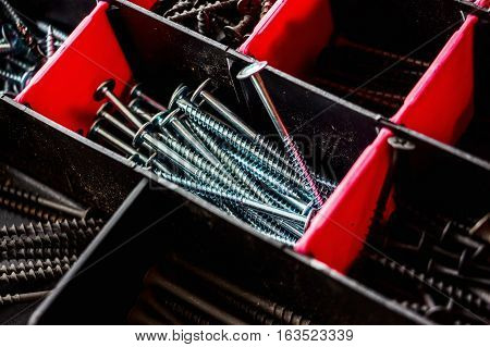 Screw in plastic organizer box close up