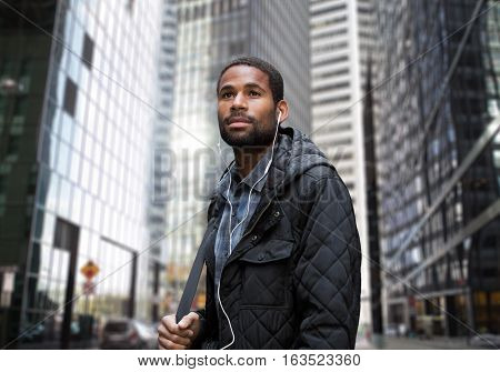 Young African American man in business district photographed in NYC in November