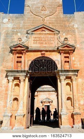 AGIA TRIADA, CRETE - SEPTEMBER 16, 2016 - Tourists standing in the entrance to the Agia Triada monastery Agia Crete Greece Europe, September 16, 2016.