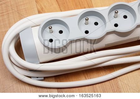 Electrical power strip with switch on-off on wooden floor electrical extension