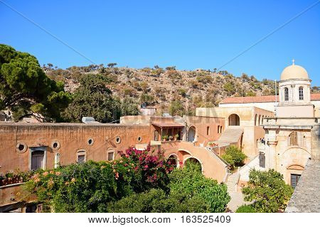 AGIA TRIADA, CRETE - SEPTEMBER 16, 2016 - Elevated view of the front of the Agia Triada monastery with courtyard buildings to the left Agia Triada Crete Greece Europe, September 16, 2016.