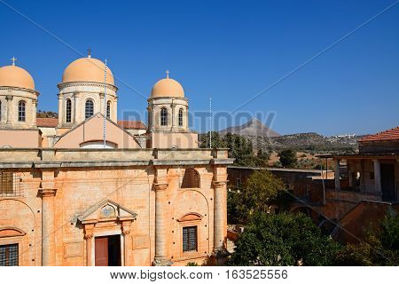 Elevated view of the front of the Agia Triada monastery with courtyard buildings to the left Agia Triada Crete Greece Europe.