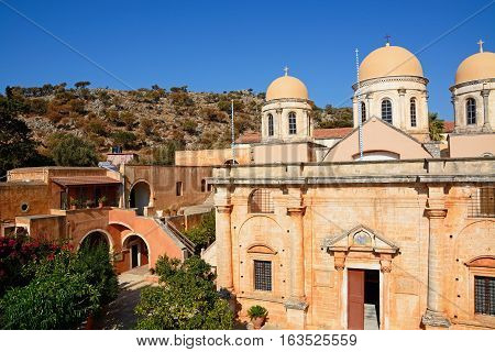 Elevated view of the front of the Agia Triada monastery and domes with courtyard buildings to the left Agia Triada Crete Greece Europe.