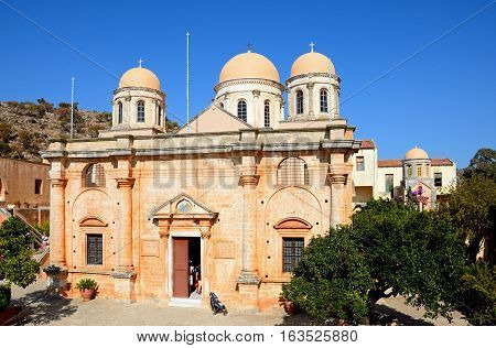 AGIA TRIADA, CRETE - SEPTEMBER 16, 2016 - Elevated view of the front of the Agia Triada monastery and domes Agia Triada Crete Greece Europe, September 16, 2016.