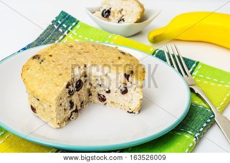 Banana curd pudding with raisins. Studio Photo
