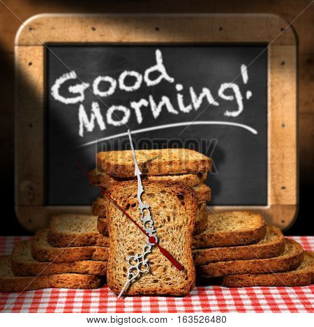Rusks of wholemeal flour on a table with a clock made with a rusk and a blackboard with text Good morning!
