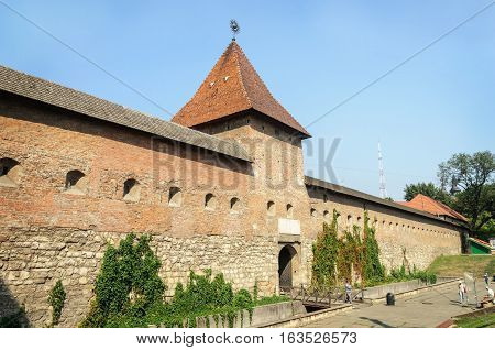 Lviv Ukraine - September 08 2016: Fortress wall (16-17 centuries) and Hlyniany Gate of Bernardine monastery