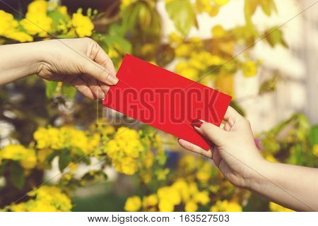 Hand Give Money In Red Envelopes - Ang Pow Or Red Packet To Someone For Chinese New Year / Tet Holid