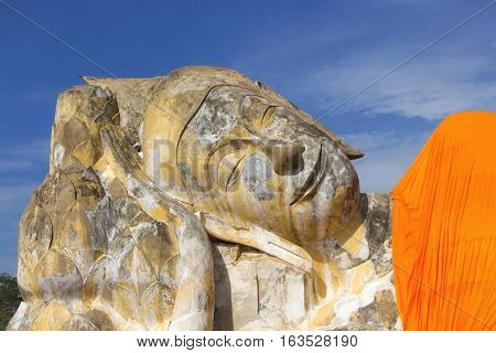 Ruin Old Reclining Buddha Image in Blue Clear Sky Background