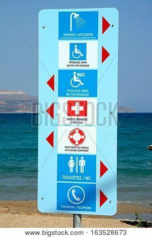 Facilities sign on the edge of the beach Kalyves Crete Greece Europe.