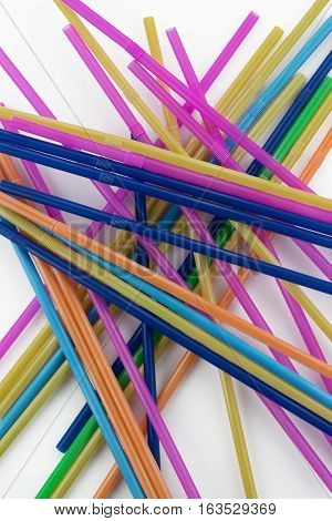 Colorful drinking plastic straws on white background