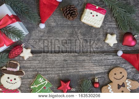 Christmas background decorate with santa claus snowman gingerbread man cookie gift box and fir tree on vintage wooden table with copy space Greeting card style for merry xmas and happy new year