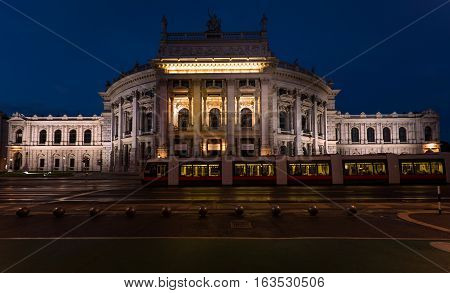VIENNA, AUSTRIA - MAY 17, 2016: Beautiful view of historic burgtheater imperial court theatre in the evening and train