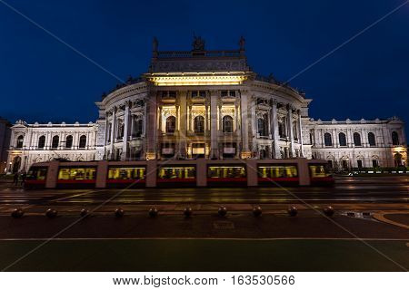 Beautiful view of historic burgtheater imperial court theatre and train in the evening, vienna, austria