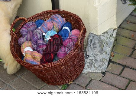 Basket with skeins of wool in different colors