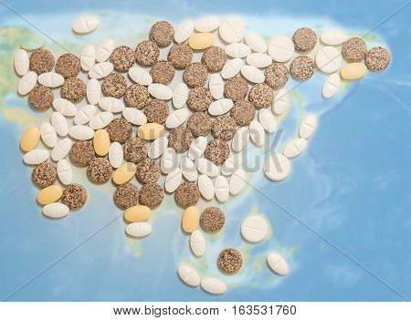 Pills in a shape of a Asia