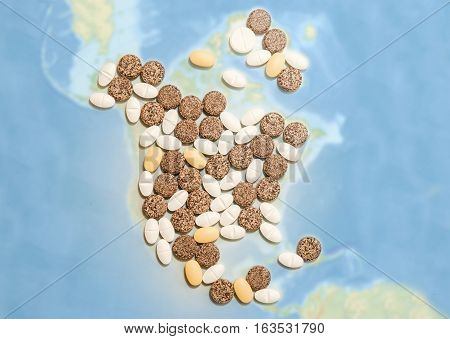 Pills in a shape of a north America