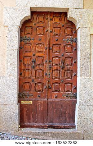 Ancient door in old castle in Tossa de Mar, Spain