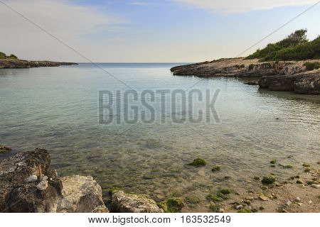 Salento coast: Porto Selvaggio Bay.ITALY (Apulia).Unspoiled nature with a small beach of sand and pebbles, surrounded by a rocky coastline.