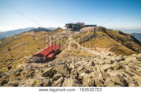 View from Mount Chopok in Low Tatras National Park with Mountain Hut and Cableway Station in Sunny Day