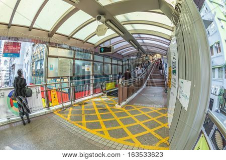 Hong Kong, China - December 4, 2016: fish eye view of Central-Mid-levels escalator on Queen's Road Central, a system of escalators and walkways connecting Central to Western District in Hong Kong.