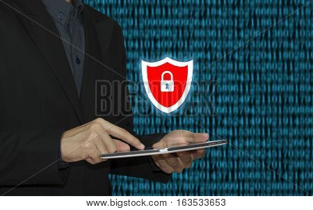 business hand typing on a laptop keyboard with cyber security firewall homepage on the computer screen privacy concept.