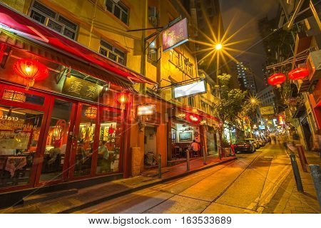 Hong Kong, China - December 10, 2016: Peking cuisine in Elgin Street by night, popular road Soho district in Central Hong Kong, famous for bars, restaurants, clubs and nightlife.